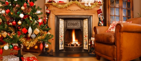 fireplace family: Christmas interior fire place in a living room in panoramic format Stock Photo