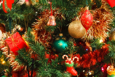 Closeup of Christmas ornaments on artifical tree