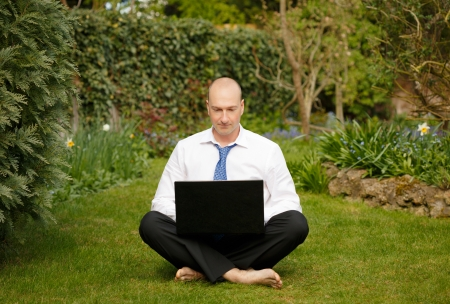 teleworking: Successful businessman in white shirt and tie working and relaxing outdoors