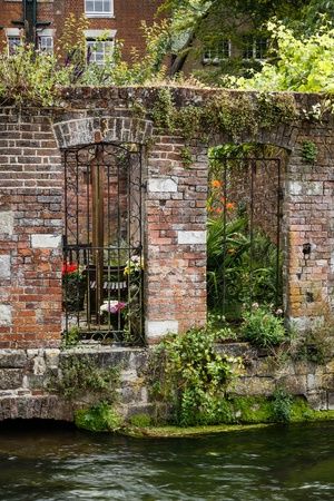 walled: Walled garden on a riverbank in Winchester, Hampshire, UK
