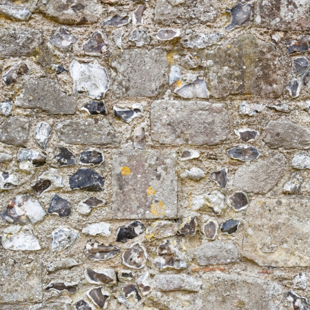 Closeup of stonework on an ancient stone wall photo