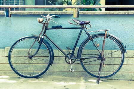 parked bicycles: Vintage retro bicycle in India, cross-processed toned image