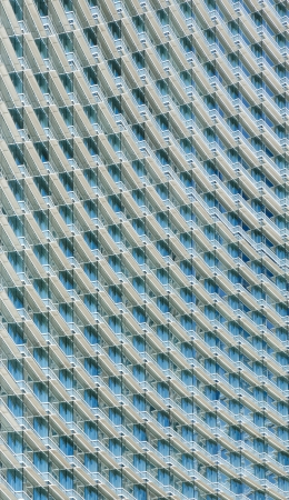 Closeup of a skyscraper office building with glass windows photo
