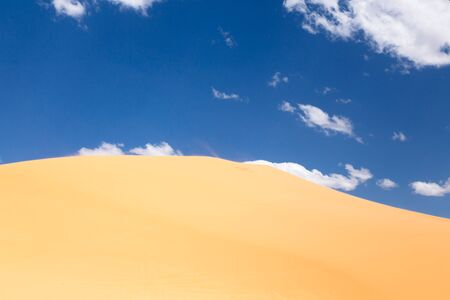 Scenic of a desert landscape with a sand dune photo
