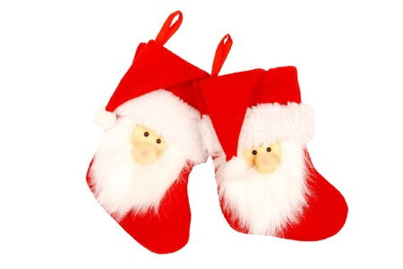 Red Christmas stockings with Santa face isolated against a white background with clipping path photo