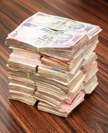 Stack of Indian rupees on a table photo
