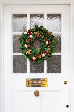 Christmas wreath hanging on door of a home photo
