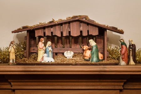 Nativity scene or creche with a stable and manger photo