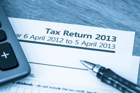 Cool toned image of UK income tax return form for 2013 photo