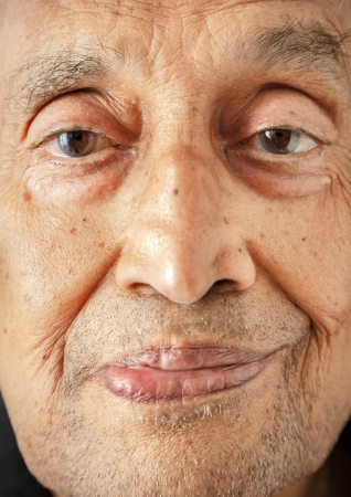 Face of an old Asian man close up
