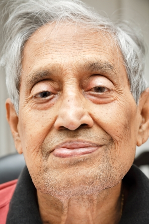 Portrait of an elderly Indian man unshaven photo
