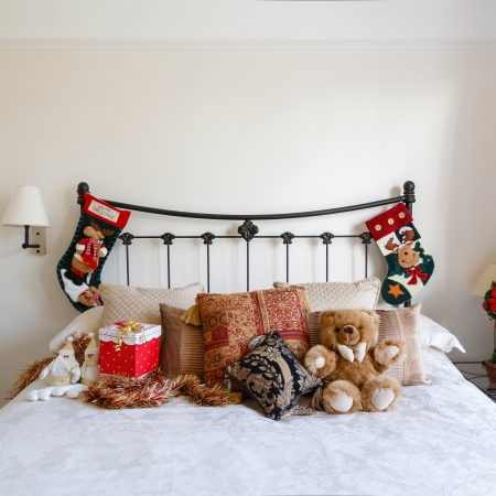 Cozy bedroom with Christmas decorations and stockings