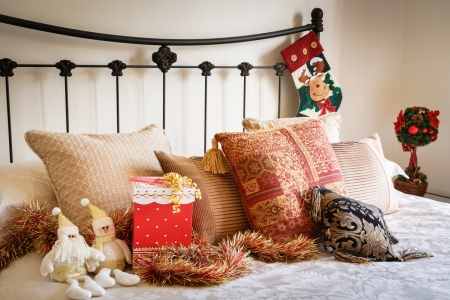 Christmas interior of modern bedroom with wrought iron bed photo