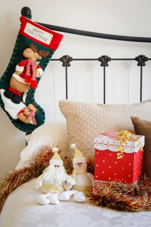 bedstead: Cozy home at Christmas time with present on the bed