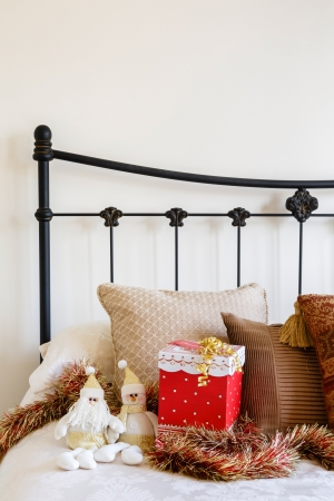 Christmas interior of contemporary bed against a neutral wall photo