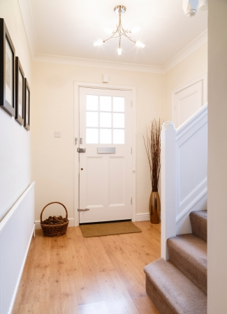 Modern hallway with a wooden floor and radiator