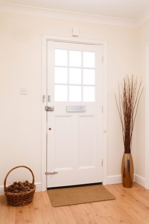 front of: Contemporary hallway in a house with a white front door