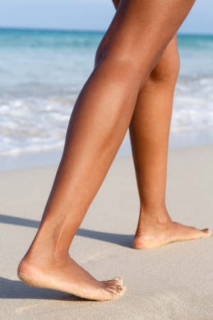 Fit woman legs showing calf muscle definition photo