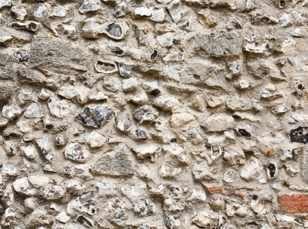 Closeup of an ancient flint and stonework castle wall photo