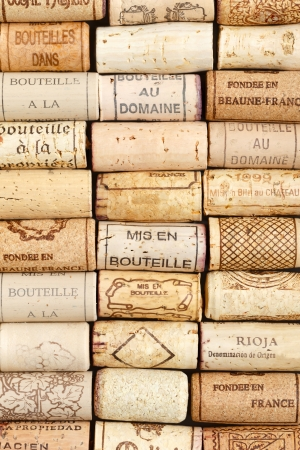 Different wine corks in a line pattern