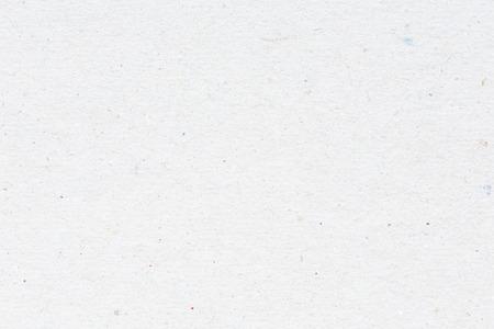 小さな色付きの斑点と白のカードのテクスチャ