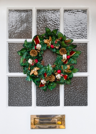 Christmas wreath on front door of a house Stock Photo - 23178160