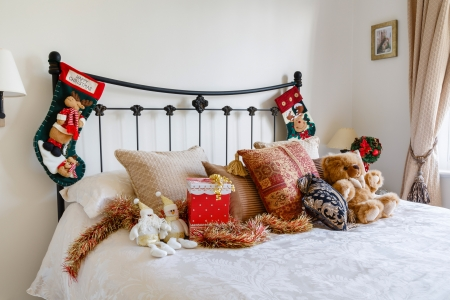 bedlinen: Cosy Christmas bedroom interior with Christmas stockings on bedpost Stock Photo