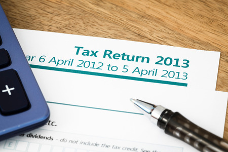 Close up of UK Income tax return form with tax period for 2013