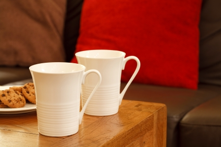 parlours: Coffee mugs with cookies in a stylish modern lounge