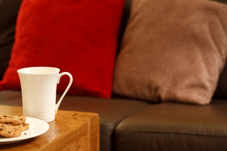 parlours: Modern living room in brown and red with coffee mugs and space for text Stock Photo