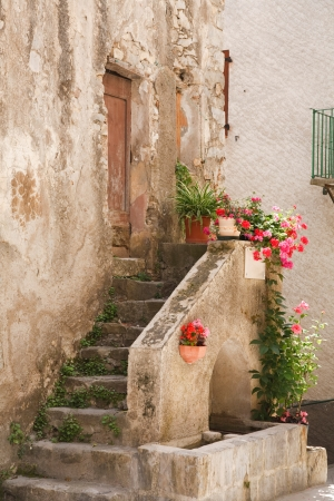 Stone steps to a medieval house in Entrevaux, France photo
