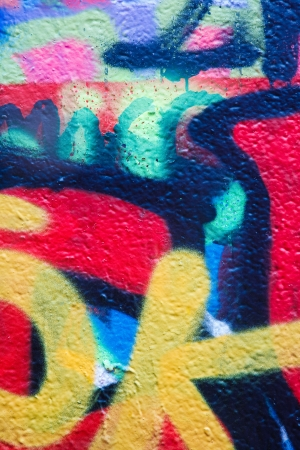 Graffiti on a wall, with detail of many different tags and colors