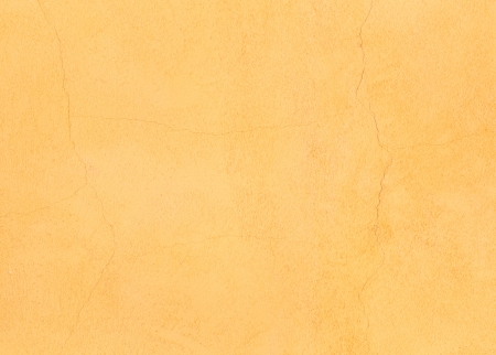 Detail of orange render or stucco texture ideal for background photo