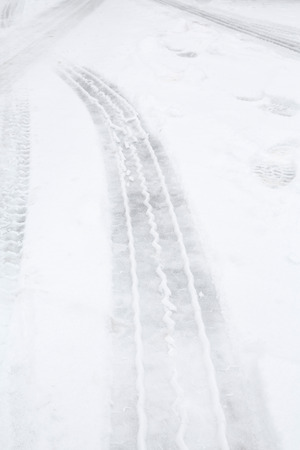 Tyre tracks on ice and snow on a highway photo