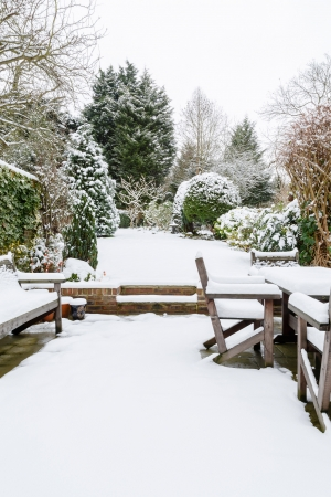 Landscaped English garden covered in snow in winter