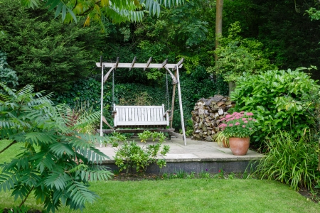 back yard: Back garden and patio with furniture in a British home
