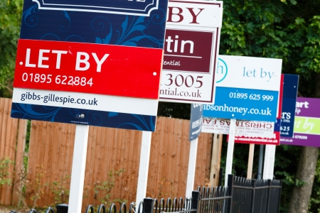 letting: London, UK, 2013  Estate agent  let by  signs advertise property in a suburb of London