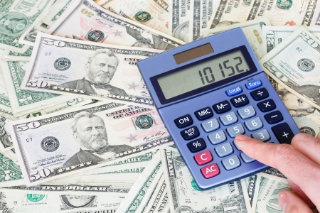 Financial background of dollar notes with a calculator photo