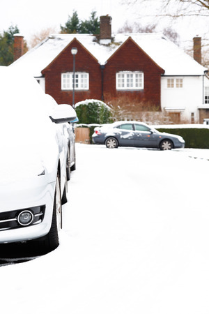 Parked cars in an English village in England in winter photo