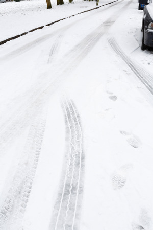 Close up of tire marks on an icy road Stock Photo