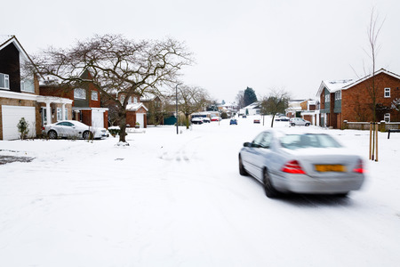 Car driving in winter snow on a road in England photo