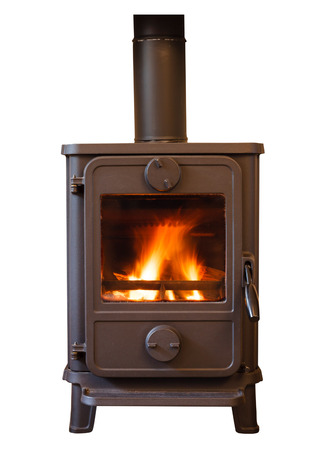 burn out: Closeup of a cosy wood burning stove Stock Photo