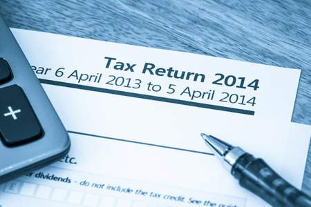 Cool toned image of UK income tax return form for 2014
