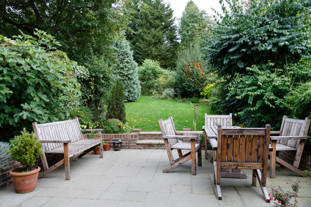 landscaped: Backyard, patio and garden furniture in an English home