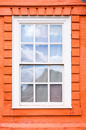 old english: Traditional wooden sash window in a historic building Stock Photo