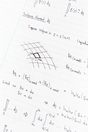formulae: Surface integration equations and diagram for physics handwritten on lined paper