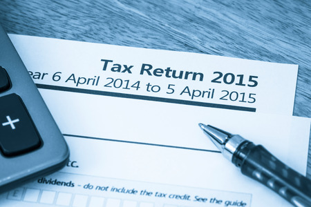 uk: Cool toned image of UK income tax return form for 2015