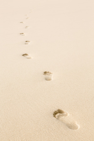 Footprints in beach sand with copy space