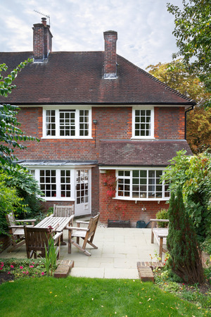 redbrick: Back of a traditional 1930s English house and garden Stock Photo