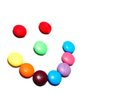 whitespace: Colorful candy smiley face on a white background with copy space